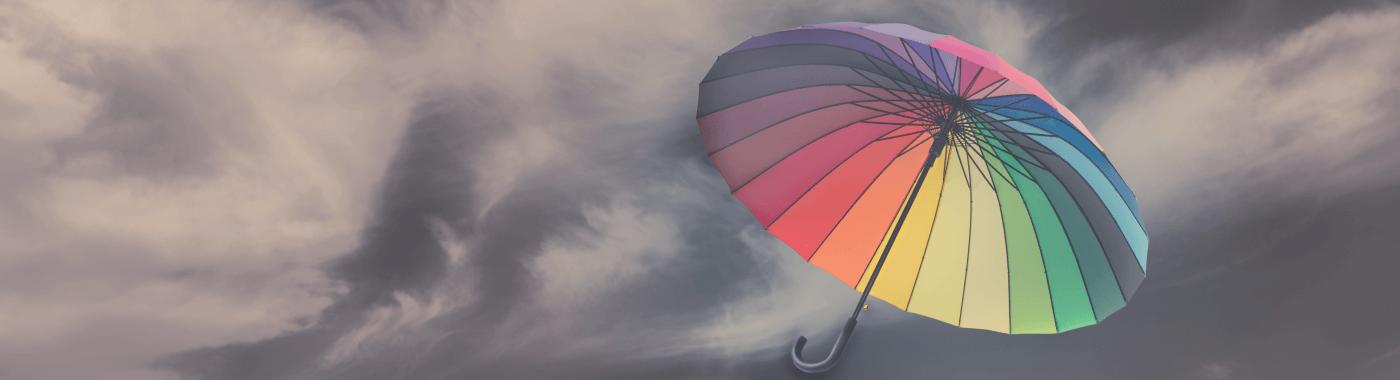 Różno barwny parasol jako symbol potrzeby dbania o Web design